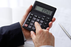 Men's hands with calculator royalty free stock photos
