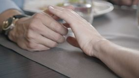 Men`s hands with a clock stroked a woman`s hand with a neat manicure. stock video footage