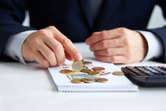 Men's hands with coins euros Royalty Free Stock Photo