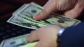 Money in the hands. Men`s hands count money. On the table is a contract stock footage