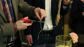 Men's hands cutting the rope with scissors. stock video