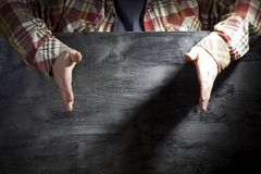 Men`s hands are divorced to the sides. royalty free stock photos