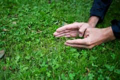 Men's hands on grass Royalty Free Stock Photography