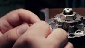 Men`s hands grind parts on the machine. Close up.