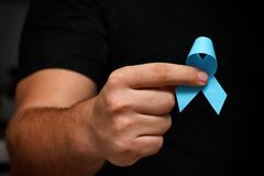 Free Men`s Hands Hold A Blue Ribbon. November Month Health Check. Prevention Of Prostatitis. Cancer Awareness. No Shave Month. Royalty Free Stock Photography - 163162147