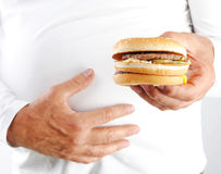 Men's hands hold the burger. Close-up Stock Photos