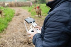 Men`s hands holding remote control of drone. Using technology royalty free stock photography