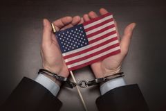Free Men`s Hands In Handcuffs Hold The American Flag In Their Hands. Concept: American Prisoner, Imaginary Freedom, Deportation Stock Images - 167988144