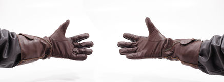 Men's hands with leather gloves. Holding something, isolated on white background Royalty Free Stock Image