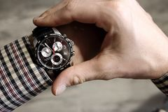 Men`s hands with modern wristwatch. Meeting and deadline concept. Elegant businessman hand top view. Success background. Stock Photo
