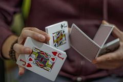 Men`s hands with playing cards Royalty Free Stock Photo