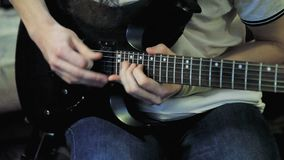 Men`s hands playing guitar solo stock footage