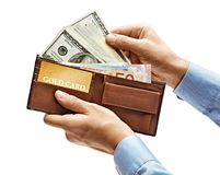 Men`s hands in shirt holding full purse of money isolated. On white background. High resolution product. Close up stock photos