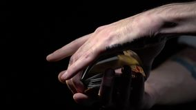Men`s hands shuffle playing cards, slow motion. The magician`s hands in tattoos show a trick with cards stock video footage