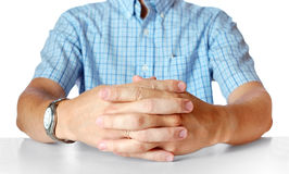Men's hands sitting opposite at the table Royalty Free Stock Photo