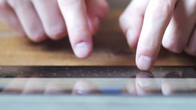 Men`s Hands Type Text on Virtual Keyboard Tablet PC on Wooden Table. Finger touching virtual keys form a digital keyboard of a touchscreen tablet device stock footage