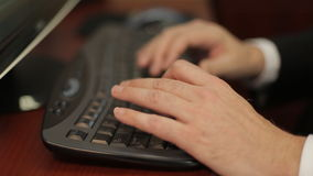 Men`s hands typing on a keyboard. In the office stock footage