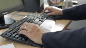 Men`s hands typing on a keyboard stock footage