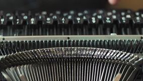 Men`s hands typing an old typewriter. The focus is not on the hands stock footage