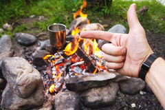 Men`s hands are warming around the fire Stock Images