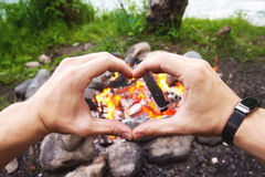 Men`s hands are warming around the fire Royalty Free Stock Image
