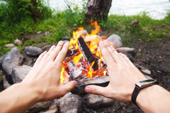 Men`s hands are warming around the fire Royalty Free Stock Photography