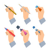 Men`s hands with writing tools and office supplies set. Royalty Free Stock Photo