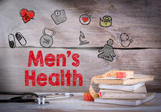 Men`s Health. Stack of books and a stethoscope on a wooden background Royalty Free Stock Photography