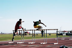 Men's High Hurdles. Action in the men,s high hurdles at a college track meet. motion blur Royalty Free Stock Photography