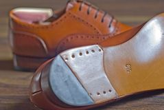 Men`s leather shoes. Men`s high quality oxford shoes with leather sole and a shoe number on it Royalty Free Stock Photos