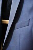 Men's jacket on a hanger Stock Image