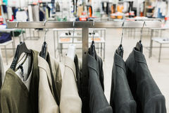 Men's jackets on a hangers Stock Image