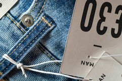 Men`s jeans with price tag. Detail of men`s jeans with price tag and price in pounds. Close up Royalty Free Stock Photos