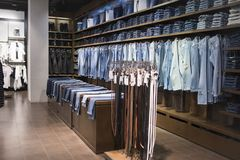 Men`s jeans store royalty free stock photography