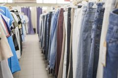 Men`s Jeans and T-Shirts. In the shop royalty free stock photography