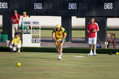 Men's Lawn Bowl Action. Image of the men's lawn bowls competition between Australia (orange/green) and Hong Kong (red/white) at the 13th Asia Pacific Bowls Stock Photography