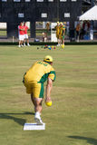 Men's Lawn Bowl Action. Image of the men's lawn bowls competition between Australia (orange/green) and Hong Kong (red/white) at the 13th Asia Pacific Bowls Royalty Free Stock Photography