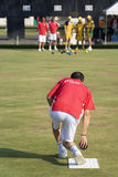 Men's Lawn Bowl Action. Image of the men's lawn bowls competition between Hong Kong (red/white) and Australia (orange/green) at the 13th Asia Pacific Bowls Stock Image