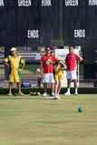 Men's Lawn Bowl Action. Image of the men's lawn bowls competition between Australia (orange/green) and Hong Kong (red/white) at the 13th Asia Pacific Bowls Royalty Free Stock Photos