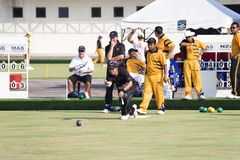 Men's Lawn Bowl Action. Image of the men's lawn bowls competition between New Zealand (black) and Malaysia (orange) at the 13th Asia Pacific Bowls Championship Stock Photos