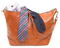 Men's leather bag with shirt, tie, sock isolated. On white background Stock Images