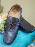 Men's Leather Loafer on Velvet Cushion as Wedding Gift Royalty Free Stock Photos