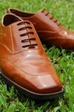 Men's Leather Shoes. A pair of leather shoes on the grass Stock Photo