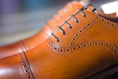 Men`s leather shoes. Closeup of men`s high quality oxford shoes Royalty Free Stock Photo