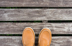 Men's leather shoes on old wood background Stock Image