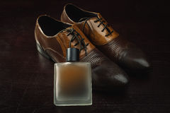 Men's leather shoes and perfume Stock Images
