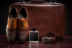 Men's leather shoes and suitcase. Men's leather shoes and a suitcase royalty free stock images