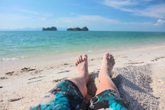 Men's legs on a beach Stock Photos