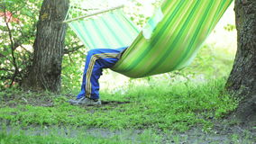 Men's legs in hammock stock video