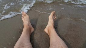 Men`s legs in the sea stock video